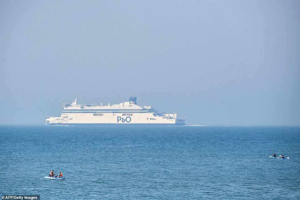A P&O cross-Channel ferry starts its voyage as people float in rubber dinghies close to the White Cliffs of Dover today