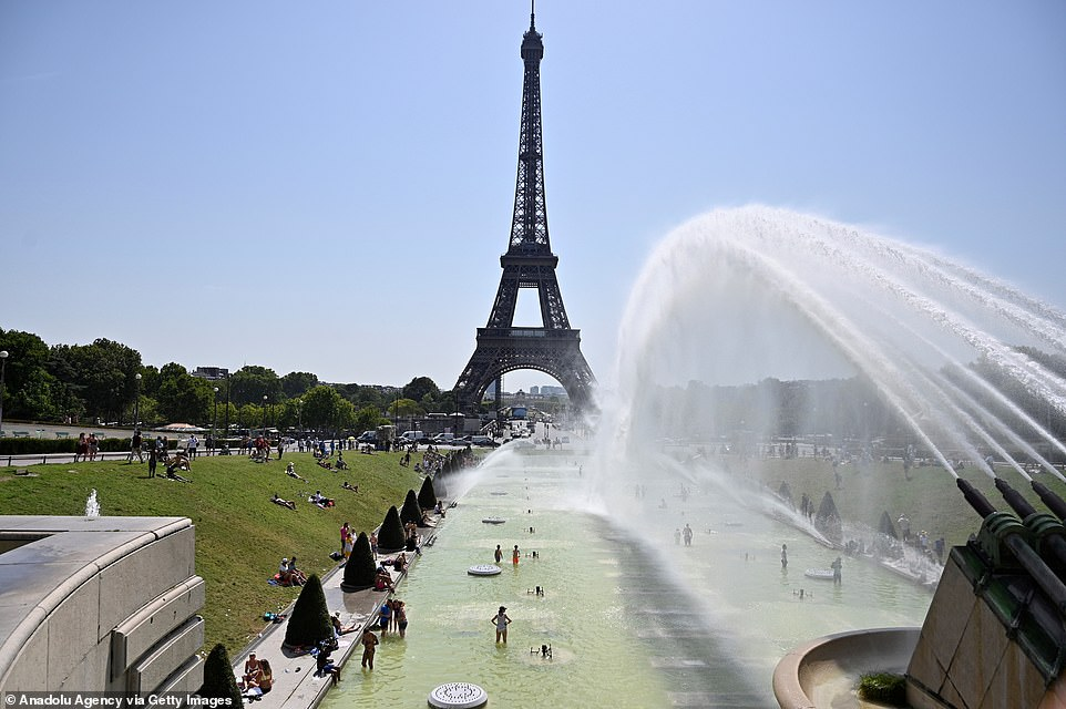 This was the scene in Paris today as the French capital recorded its highest ever temperature at109F (42.6C)