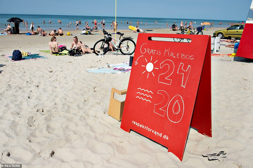 A sign displays the water temperatures atBlokhus, in Denmark, on Thursday
